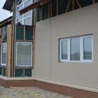 Коттедж отделка фасадными панелями